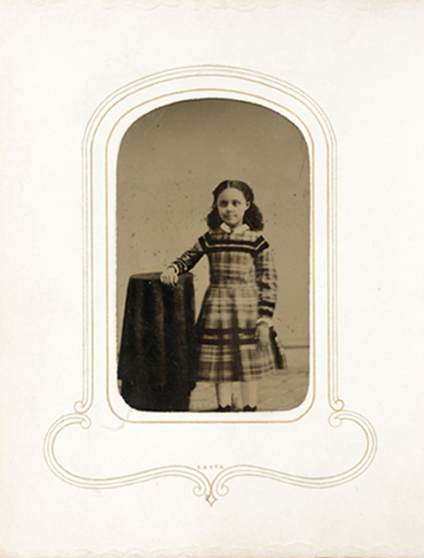 1.16. Girl in plaid dress. Tintype.