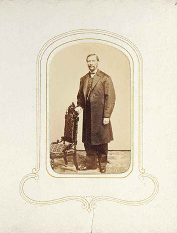 1.23, Man standing with chair. Churchill & Denison, Albany, NY. CDV.