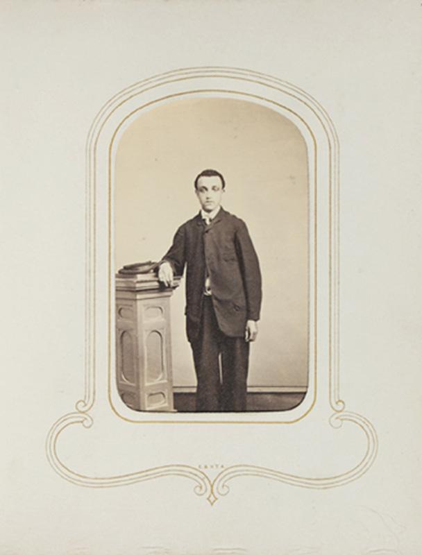 1.45. Man standing with column. J.H. & J.L. Abbott, Albany, NY. CDV.