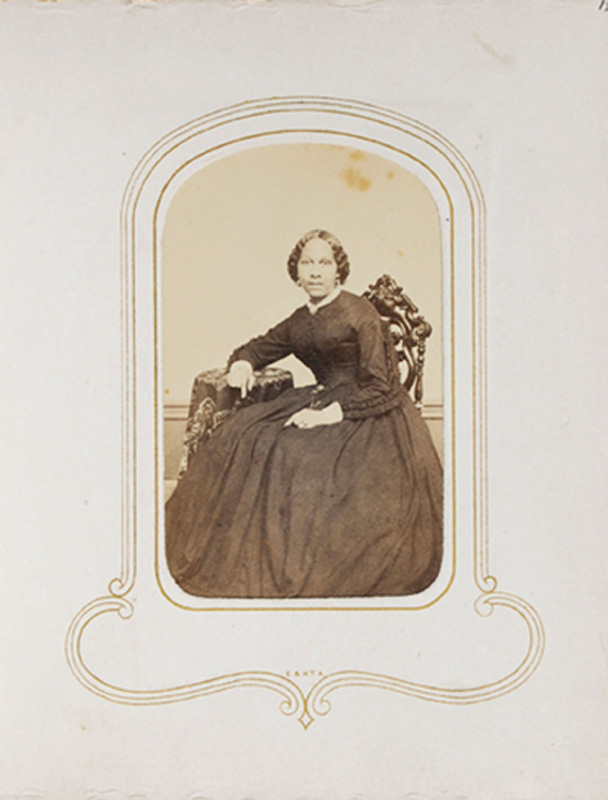 1.47. Woman seated, leaning. R. Warren, Springfield, MA. CDV.
