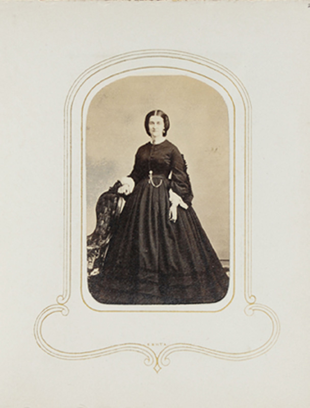 1.51. Woman standing with upholstered chair. S.J. Thompson, Albany, NY. CDV.