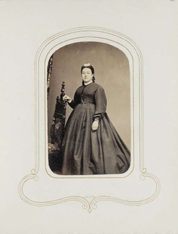 1.53. Woman with bow, standing. Thomas Heney, NYC. CDV.
