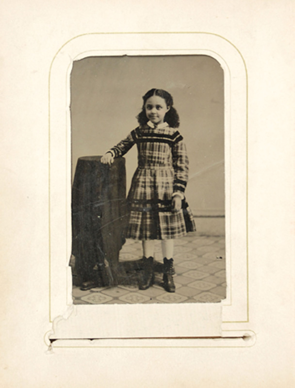 2.36. Girl in plaid dress. Tintype.